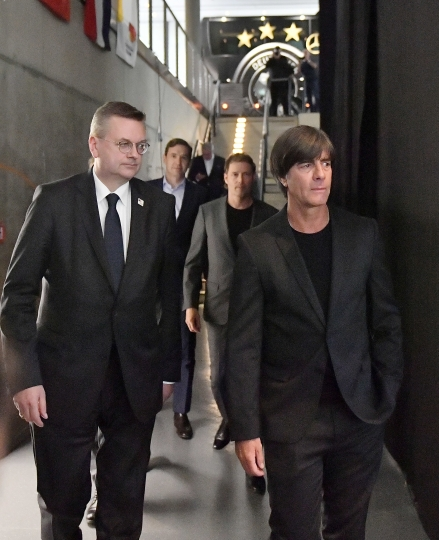 DFB (German Football Association) President Reinhard Grindel, left, and head coach Joachim Loew, right, arrive at the German Football Museum in Dortmund, Germany, Tuesday, May, 15, 2018 for the presentation of Germany's team for the Soccer World Cup in Russia. (AP Photo/Martin Meissner)