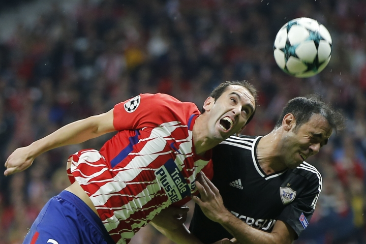 FILE - In this Tuesday, Oct. 31, 2017 file photo, Atletico's Diego Godin, left, and Qarabag's Elvin Ismayilov jump for the ball during a Group C Champions League soccer match between Atletico Madrid and Qarabag at the Metropolitano stadium in Madrid, Spain. Marseille will play Atletico Madrid in the Europa League final on Wednesday May 16, 2018. The Uruguay center back is a large reason why Atletico remains arguably the best defensive team among Europe's elite. (AP Photo/Paul White, File)