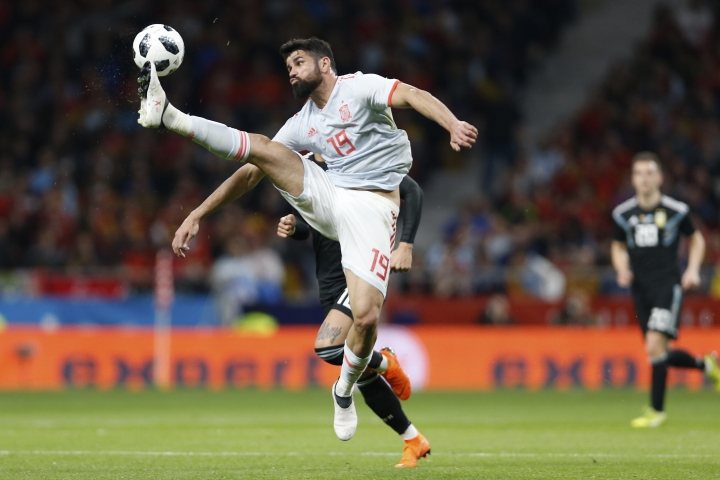 FILE - In this Tuesday, March 27, 2018 file photo, Spain's Diego Costa controls the ball in front of Argentina's Marcos Rojo during the international friendly soccer match between Spain and Argentina at the Wanda Metropolitano stadium in Madrid, Spain. Marseille will play Atletico Madrid in the Europa League final on Wednesday May 16, 2018. The Brazilian-born striker returned to Atletico this season and has a chance to help the team win a third Europa League title in a decade. (AP Photo/Francisco Seco, File)