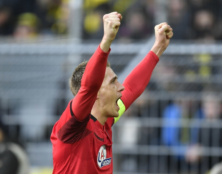 In this Saturday, Jan. 27, 2018 photo Freiburg's Nils Petersen celebrates after scoring his side's first goal during the German Bundesliga soccer match between Borussia Dortmund and SC Freiburg in Dortmund, Germany. Petersen was presented on Thuessday, May 15, 2018 as a member of the German national soccer team for the world cup in Russia. (AP Photo/Martin Meissner)
