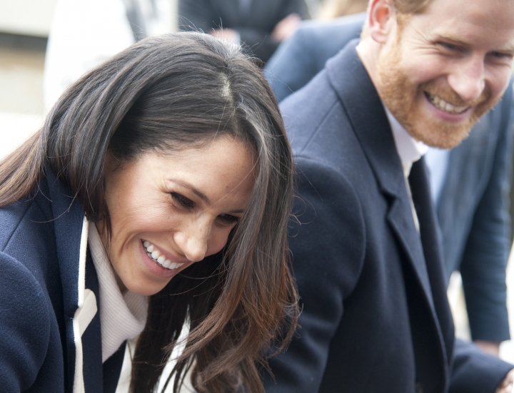 "FILE - In this file photo dated Thursday March 8, 2018, Britain's Prince Harry and his fiancee Meghan Markle arrive for an event for young women, as part of International Women's Day in Birmingham, central England. Kensington Palace said Monday May 14, 2018, that Britain's Prince Harry and Meghan Markle are requesting ""understanding and respect"" for Markle's father after a celebrity news site reported he would not be coming to the royal wedding to walk his daughter down the aisle. (AP Photo/Rui Vieira, FILE)"