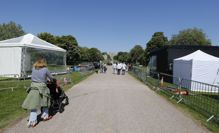 Tents are build up for the international media on the Long Walk leading towards Windsor Castle in Windsor, England, Tuesday, May 15, 2018. Preparations continue in Windsor ahead of the royal wedding of Britain's Prince Harry and Meghan Markle Saturday May 19. (AP Photo/Frank Augstein)