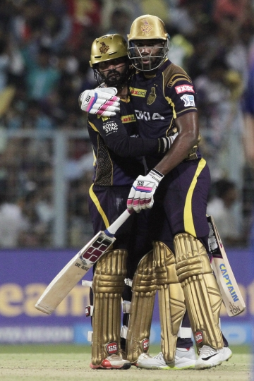Kolkata Knight Riders' Andre Russel, right and Dinesh Karthik react after their win by six wickets over the Rajasthan Royals during the VIVO IPL cricket T20 match in Kolkata, India, Tuesday, May 15, 2018. (AP Photo/Bikas Das)