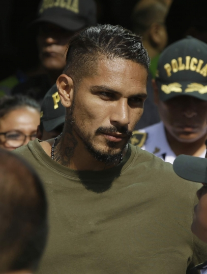 "Peru captain Paolo Guerrero arrives in Lima, Peru, Tuesday, May 15, 2018. The global footballers' union wants FIFA's help to review anti-doping rules after Guerrero was banned from the World Cup for a positive test for cocaine caused by contaminated tea. FIFPro says a 14-month ban barring the 34-year-old Guerrero from his World Cup debut is ""unfair and disproportionate."" (AP Photo/Martin Mejia)"