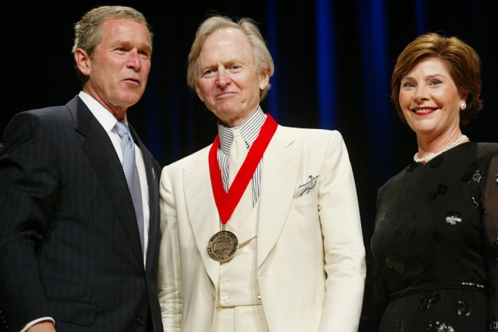 CORRECTS AGE TO 88 - FILE - In this April 22, 2002 file photo, President Bush, left, poses with author Tom Wolfe, center, and first lady Laura Bush during the National Endowment for the Arts National Medal Awards ceremony at Constitution Hall in Washington . Wolfe was a recipient of the National Humanities Medal. Wolfe died at a New York City hospital. He was 88. Additional details were not immediately available. (AP Photo/Pablo Martinez Monsivais, File)