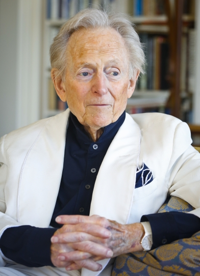 """CORRECTS AGE TO 88 - FILE - In this July 26, 2016 file photo, American author and journalist Tom Wolfe, Jr. appears in his living room during an interview about his latest book, """"The Kingdom of Speech,"""" in New York. Wolfe died at a New York City hospital. He was 88. Additional details were not immediately available. (AP Photo/Bebeto Matthews, File)"""