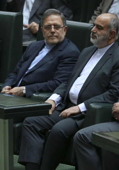 In this Aug. 20, 2017 photo, Iran's Central Bank Governor, Valiollah Seif, sits in an open session of parliament, in Tehran, Iran. The United States escalated its financial pressure on Iran Tuesday, May 15, 2018, by slapping terror sanctions on the head of its central bank and barring anyone around the world from doing business with him, underscoring President Donald Trump's hard line after his withdrawal from the Iranian nuclear accord upset European allies. (AP Photo/Vahid Salemi)