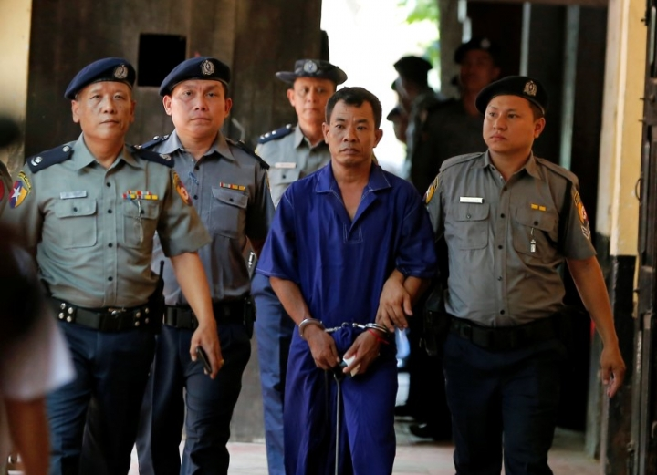 Detained Police Captain Moe Yan Naing (C) escorted by police arrives for a court hearing in Yangon, Myanmar May 9, 2018. REUTERS/Stringer