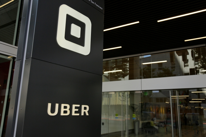 FILE - This June 21, 2017, file photo shows the building that houses the headquarters of Uber, in San Francisco. Uber's ride-hailing service will give its U.S. passengers and drivers more leeway to pursue claims of sexual misconduct, its latest attempt to reverse its reputation for brushing aside bad behavior. The shift announced Tuesday, May 15, 2018, will allow riders and drivers to file allegations of rape, sexual assault and harassment in courts and mediation instead of being locked into an arbitration hearing. (AP Photo/Eric Risberg, File)