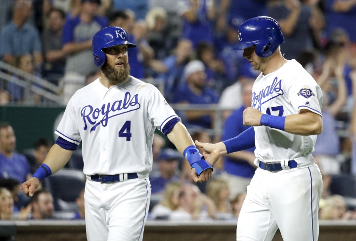 Kansas City Royals' Alex Gordon (4) and Hunter Dozier celebrate after they scored on a single by Whit Merrifield during the seventh inning of a baseball game against the Tampa Bay Rays on Tuesday, May 15, 2018, in Kansas City, Mo. (AP Photo/Charlie Riedel)