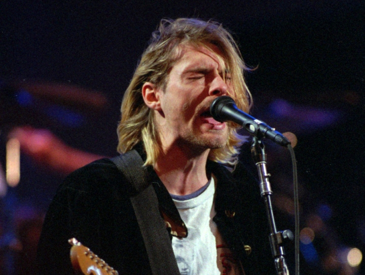 "FILE - This Dec. 13, 1993 file photo shows Kurt Cobain of the band Nirvana performing in Seattle. The Washington State Court of Appeals has ruled that photographs from the scene of Nirvana frontman Cobain's death will not be released publicly. KING5-TV reports the court ruled Tuesday, May 15, 2018, that the photographs are exempt from Washington state's Public Records Act and releasing the photos would ""violate the Cobain family's due process rights under the 14th Amendment."" (AP Photo/Robert Sorbo, File)"