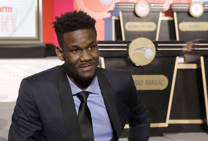 DeAndre Ayton from Arizona sits on the stage before the NBA basketball draft lottery Tuesday, May 15, 2018, in Chicago. (AP Photo/Charles Rex Arbogast)