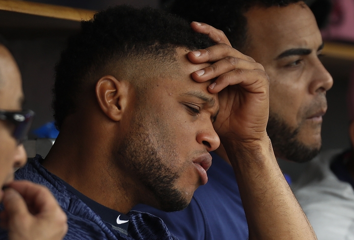 In this Sunday, May 13, 2018 photo, Seattle Mariners' Robinson Cano sits on the bench against the Detroit Tigers in the fifth inning of a baseball game in Detroit. Seattle Mariners All-Star second baseman Robinson Cano has been suspended 80 games for violating baseball's joint drug agreement, Tuesday, May 15, 2018. (AP Photo/Paul Sancya)