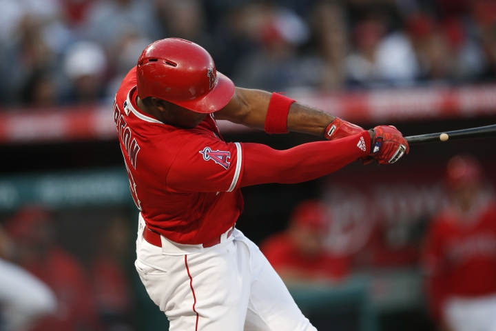 Los Angeles Angels' Justin Upton swings for a two-run home run during the first inning of a baseball game against the Houston Astros on Tuesday, May 15, 2018, in Anaheim, Calif. (AP Photo/Jae C. Hong)