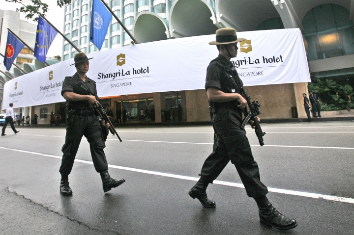 FILE - In this July 21, 2008, file photo, Singapore police officers patrol outside the Shangri-La hotel, a possible venue for the Trump-Kim summit, in Singapore. A new law that gives the police special powers during terrorist attacks, including widely banning journalists and members of the public from reporting on the scene, took effect in Singapore on Wednesday, May 16, 2018. (AP Photo/Dita Alangkara, File)