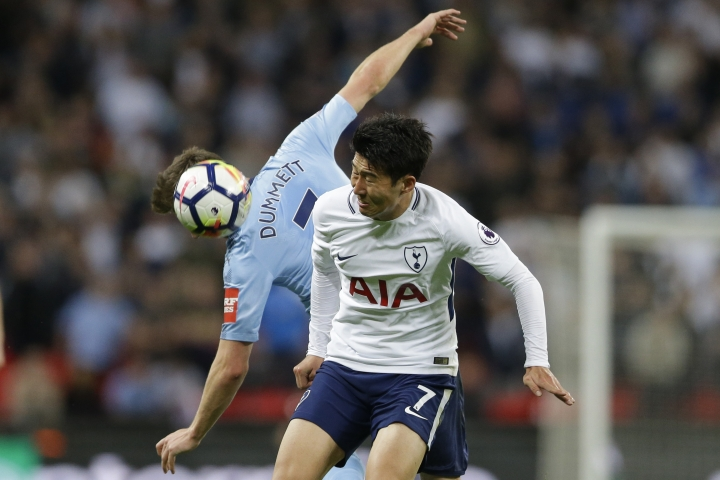 Newcastle United's Paul Dummett, rear, and Tottenham Hotspur's Son Heung-min vie for the ball during the English Premier League soccer match between Tottenham Hotspur and Newcastle United at Wembley Stadium, in London, England, Wednesday, May 9, 2018. (AP Photo/Alastair Grant)