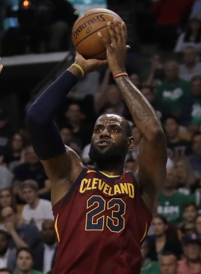 Cleveland Cavaliers forward LeBron James shoots against the Boston Celtics during the first half in Game 2 of the NBA basketball Eastern Conference finals Tuesday, May 15, 2018, in Boston. (AP Photo/Charles Krupa)