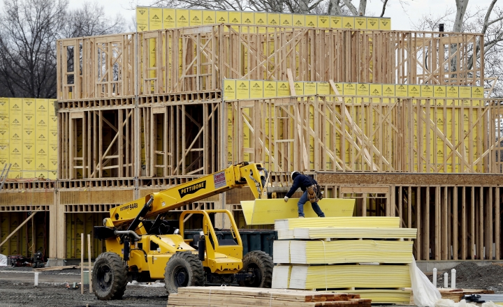 FILE- In this Feb. 26, 2018, file photo, work continues on a new development in Fair Lawn, N.J. On Tuesday, May 15, the National Association of Home Builders/Wells Fargo releases its May index of builder sentiment. (AP Photo/Seth Wenig, File)