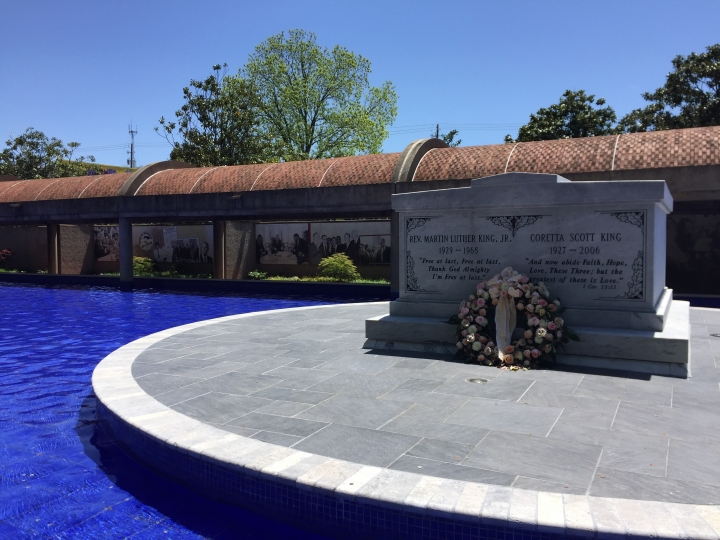 This April 29, 2018 photo shows the tomb where Martin Luther King, Jr., and his wife Coretta Scott King are interred in Atlanta at the King Center. Nearby attractions include the house where he was born and lived until the age of 12, along with a National Park Service visitor center with exhibits about his life and the civil rights movement. (AP Photo/Beth J. Harpaz)