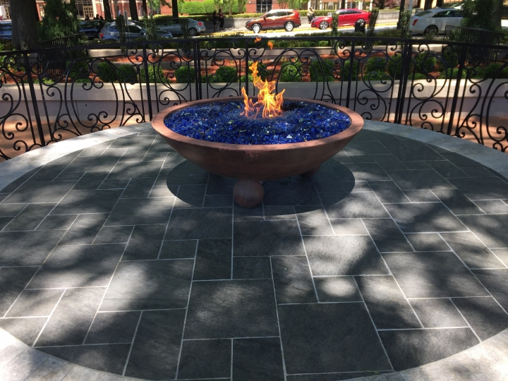 This April 29, 2018 photo shows the eternal flame located across from the tomb where Martin Luther King, Jr., and his wife Coretta Scott King are interred in Atlanta at the King Center. Nearby attractions include the house where he was born and lived until the age of 12, along with a National Park Service visitor center with exhibits about his life and the civil rights movement. (AP Photo/Beth J. Harpaz)