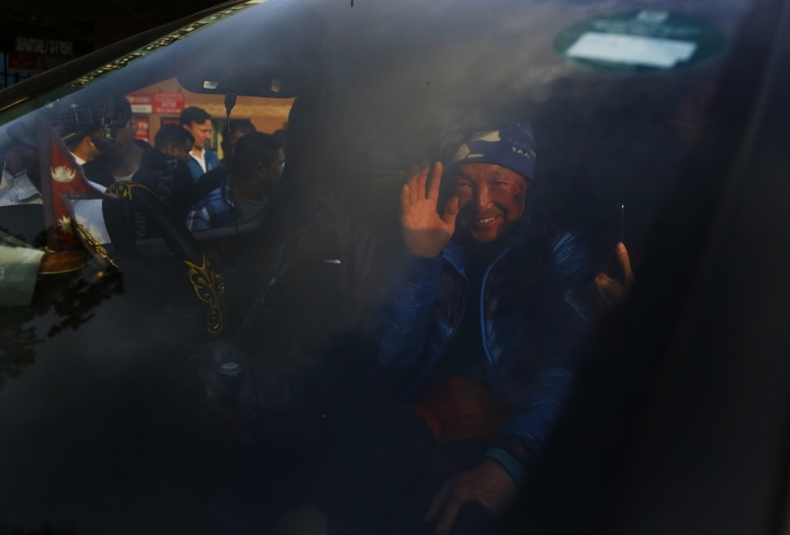 Chinese climber Xia Boyu, 69, waves as he arrives in Kathmandu after successfully summiting Mount Everest, Wednesday, May 16, 2018. Boyu, who lost both his feet while trying to reach summit, has successfully climb Everest on his fifth attempt. (AP Photo/Niranjan Shrestha)