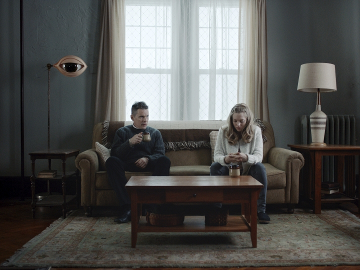 "This image released by A24 shows Ethan Hawke, left, and Amanda Seyfriend in a scene from ""First Reformed."" (A24 via AP)"