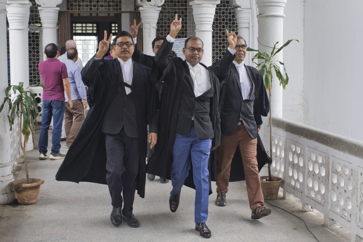 Lawyer supporting opposition Bangladesh Nationalist Party (BNP) show victory sign as they leave the Supreme Court after the court upheld a High Court's decision to grant bail to opposition leader and former Prime Minister Khaleda Zia in Dhaka, Bangladesh, Wednesday, May 16, 2018. Zia, was jailed for five years on a corruption conviction. (AP Photo/A. M. Ahad)