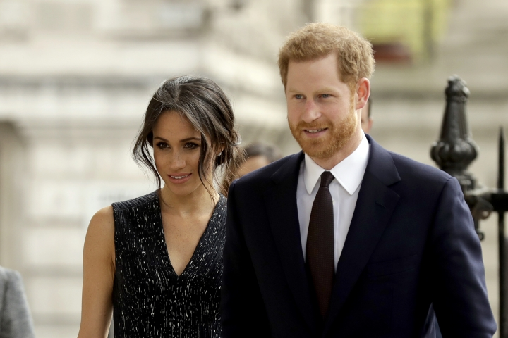 """FILE - In this Monday, April 23, 2018 file photo, Britain's Prince Harry and his fiancee Meghan Markle arrive to attend a Memorial Service to commemorate the 25th anniversary of the murder of black teenager Stephen Lawrence at St Martin-in-the-Fields church in London. German royalists' adrenaline has been surging as the Saturday, May 19 wedding of Prince Harry and his American bride-to-be Meghan Markle is creeping closer. There's no way anybody here will be able to miss the event: Three German TV stations, ZDF, RTL and n-tv, will broadcast the event live and stream it on their websites too. Dozens of German correspondents are accredited and so-called """"royal household experts"""" will explain the intricacies of the foreign ceremony. (AP Photo/Matt Dunham, file)"""