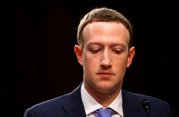 FILE PHOTO: Facebook CEO Mark Zuckerberg listens while testifying before a joint Senate Judiciary and Commerce Committees hearing regarding the company's use and protection of user data, on Capitol Hill in Washington, U.S., April 10, 2018. Picture taken April 10, 2018.  REUTERS/Leah Millis/File Photo