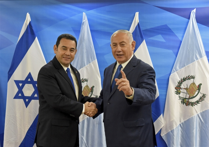 Guatemalan President Jimmy Morales, left, shakes hands with Israeli Prime Minister Benjamin Netanyahu in the prime minister's office in Jerusalem, Wednesday, May 16, 2018. Guatemala has opened its new embassy in Jerusalem, becoming the second country to do so after the United States. Morales dedicated the embassy just two days after a high-powered American delegation also marked the transfer of its embassy in Israel from Tel Aviv to Jerusalem. (Debbie Hill/Pool Photo via AP)