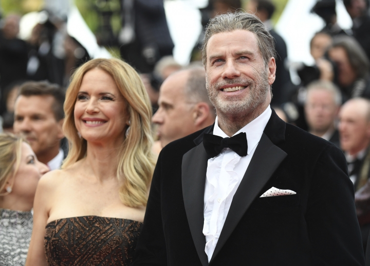 Actors Kelly Preston, left, and John Travolta from the film 'Gotti' pose for photographers upon arrival at the premiere of the film 'Solo: A Star Wars Story' at the 71st international film festival, Cannes, southern France, Tuesday, May 15, 2018. (Photo by Arthur Mola/Invision/AP)