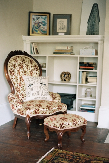 "This undated photo provided by the F. Scott and Zelda Fitzgerald Museum in Montgomery, Ala., shows a pillow on a chair embroidered with a quote from Zelda Fitzgerald: ""She refused to be bored chiefly because she wasn't boring."" The chair is in an apartment upstairs from the museum. The apartment and museum are located in a 1910 house where the Fitzgeralds lived in the 1930s. The apartment can be rented on Airbnb and is also used for writers' residencies. (Jonathon Kohn/F. Scott and Zelda Fitzgerald Museum via AP)"