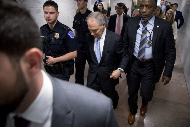Environmental Protection Agency Administrator Scott Pruitt, accompanied by security, departs after testifying before a Senate Appropriations subcommittee on the Interior, Environment, and Related Agencies on budget on Capitol Hill in Washington, Wednesday, May 16, 2018. Pruitt goes before a Senate panel Wednesday as he faces a growing number of federal ethics investigations over his lavish spending on travel and security. (AP Photo/Andrew Harnik)