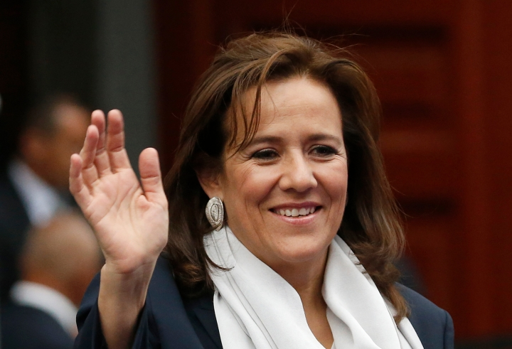 FILE - In this April 22, 2018 file photo, former first lady and independent presidential candidate Margarita Zavala waves to the press before the first of three debates among Mexico's presidential candidates in Mexico City. Zavala said on Wednesday, May 16 that she is dropping out of the country's July 1 presidential race. (AP Photo/Marco Ugarte, File)