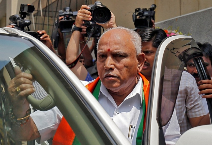 India's ruling Bharatiya Janata Party (BJP) leader and former Chief Minister of the southern state of Karnataka B. S. Yeddyurappa leaves to meet the state governor to stake claim to form the government, in Bengaluru, India, May 16, 2018. REUTERS/Abhishek N. Chinnappa