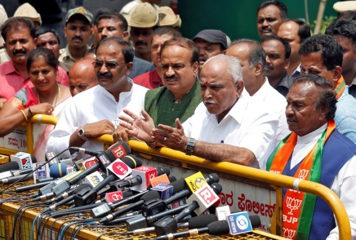 India's ruling Bharatiya Janata Party (BJP) leader and former Chief Minister of the southern state of Karnataka B. S. Yeddyurappa speaks with the media after meeting with the state governor to stake claim to form the government, outside the governor's house in Bengaluru, India, May 16, 2018. REUTERS/Abhishek N. Chinnappa