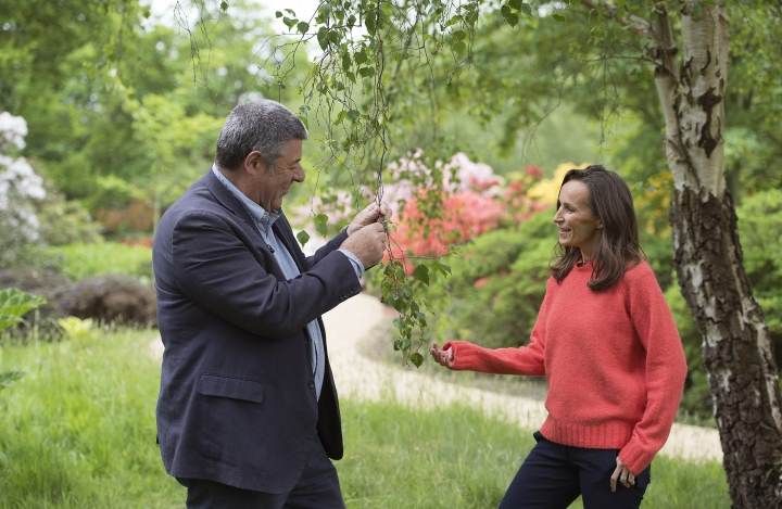 Floral designer Philippa Craddock, right and Keeper of the Gardens John Anderson are photographed in the Savill Garden, in Windsor Great Park, Windsor, England, Wednesday, May 16, 2018, as they look at leaves to be used in the floral displays at St George's Chapel. The arrangements will be created using locally sourced foliage, much of which will be taken from the gardens and parkland of Windsor Great Park. (Eddie Mulholland/Pool Photo via AP)