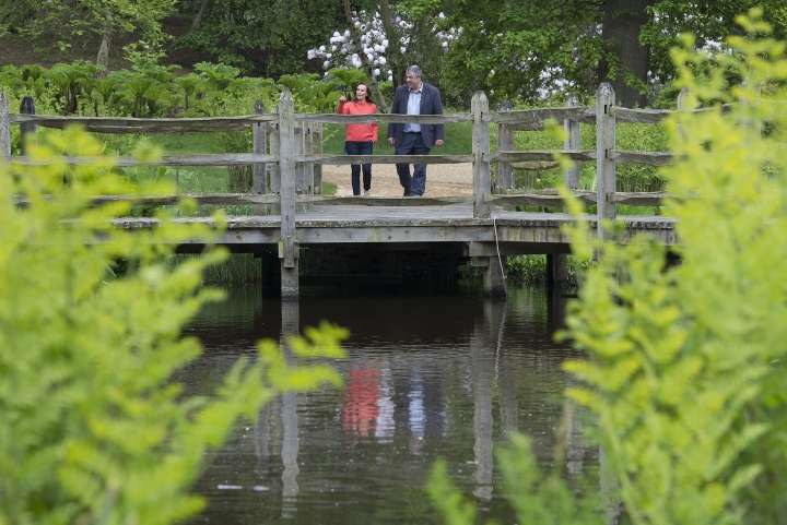 Floral designer Philippa Craddock, and Keeper of the Gardens John Anderson are photographed in the Savill Garden, in Windsor Great Park, Windsor, England, Wednesday, May 16, 2018, as they look at leaves to be used in the floral displays at St George's Chapel. The arrangements will be created using locally sourced foliage, much of which will be taken from the gardens and parkland of Windsor Great Park. (Eddie Mulholland/Pool Photo via AP)