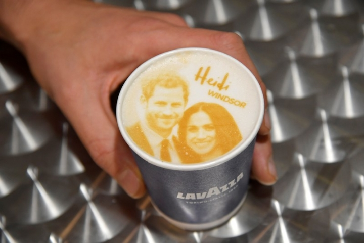 An image of Britain's Prince Harry and his fiancee Meghan Markle is seen on top of a cup of coffee being sold ahead of their forthcoming wedding in Windsor. REUTERS/Toby Melville