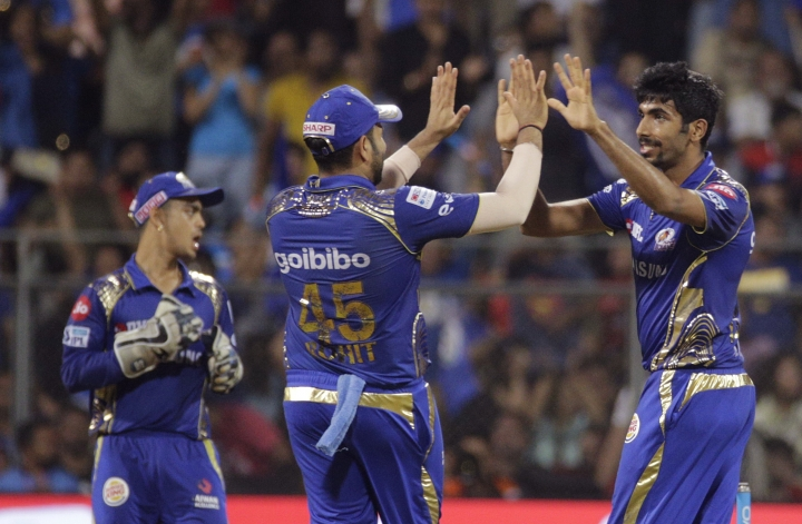 Mumbai Indians' Jasprit Bumrah, right, celebrate the dismissal of King XI Punjab's Marcus Stoinis with teammates, during the VIVO IPL cricket T20 match in Mumbai, India, Wednesday, May 16, 2018. (AP Photo/Rafiq Maqbool)