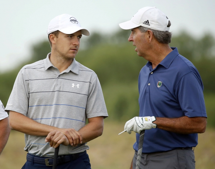 Jordan Spieth, left, talks with Robert Rowling during the pro-am at the AT&T Byron Nelson golf tournament at Trinity Forest Golf Club in Dallas, Wednesday, May 16, 2018. (Vernon Bryant/The Dallas Morning News via AP)