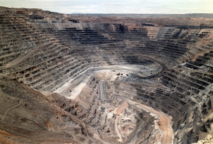 FILE - This undated file photo shows Barrick Goldstrike Mines' Betze-Post open pit near Carlin, Nev. Environmental groups challenged the Trump administration in federal court Wednesday, May 16, 2018, over its rejection of an Obama-era proposal that would have required mining companies to prove they have enough money to clean up their pollution. (Adella Harding/The Daily Free Press via AP, File)