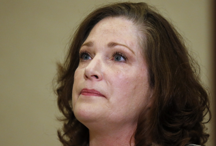 FILE - In this April 5, 2018 file photo McKenna Denson speaks with reporters during a news conference in Salt Lake City. The Mormon church has asked a judge to toss out a lawsuit accusing leaders of brushing aside rape allegations against Denson, a former missionary training center director. Many people who could have testified about what happened in the 1980s have died or have only cloudy memories, leaving the faith unable to fully defend itself, The Church of Jesus Christ of Latter-day Saints says in court documents filed Tuesday, May 15, 2018, Denson has said she reported several times over the last three decades that Joseph L. Bishop sexually assaulted her, but the church failed to take disciplinary action. (AP Photo/Rick Bowmer,File)
