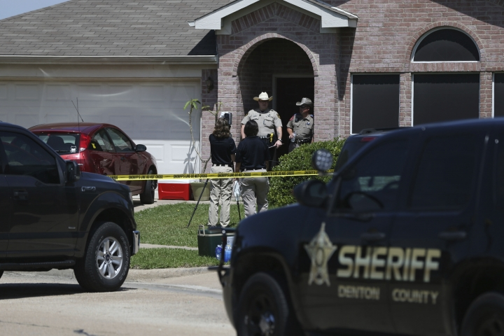 Denton County Sheriff's officers investigate a crime scene at a home where multiple people were killed and one was hospitalized after a shooting at a home in the Remington Park neighborhood of Ponder, Texas, on Wednesday, May 16, 2018. (Rose Baca/The Dallas Morning News via AP)