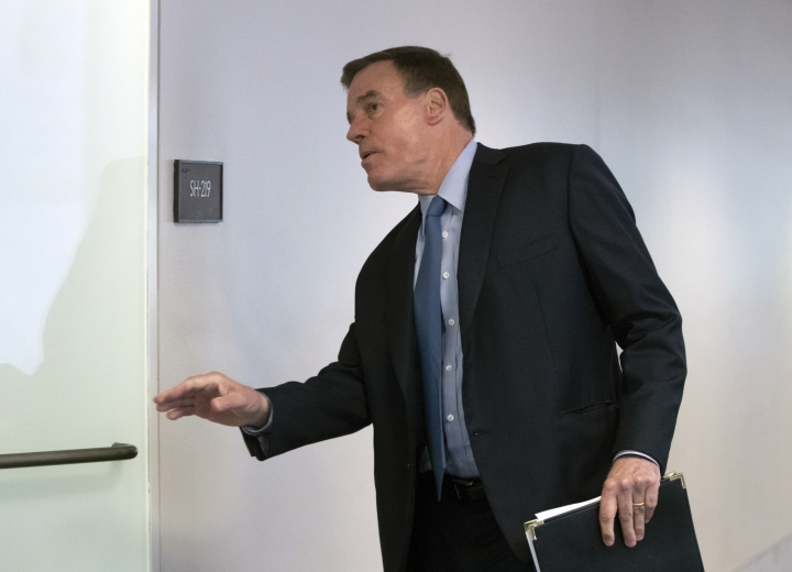 """Senate Intelligence Committee Vice Chairman Mark Warner, D-Va., goes behind closed doors as members of the Senate Intelligence Committee arrive to vote on Gina Haspel, President Donald Trump's pick to lead the Central Intelligence Agency, on Capitol Hill in Washington, Wednesday, May 16, 2018. In announcing his support for the nominee, Warner said Haspel has been """"professional and forthright"""" with the intelligence committee, """"Most importantly, I believe she is someone who can and will stand up to the president if ordered to do something illegal or immoral - like a return to torture."""" (AP Photo/J. Scott Applewhite)"""