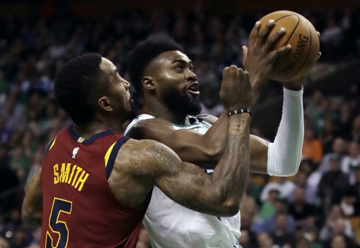 Boston Celtics guard Jaylen Brown, right, tries to drive against Cleveland Cavaliers guard JR Smith (5) during the second half in Game 2 of the NBA basketball Eastern Conference final, Tuesday, May 15, 2018, in Boston. (AP Photo/Charles Krupa)