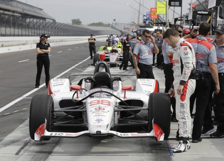 Marco Andretti looks at his car during a practice session for the IndyCar Indianapolis 500 auto race at Indianapolis Motor Speedway in Indianapolis, Wednesday, May 16, 2018. (AP Photo/Darron Cummings)