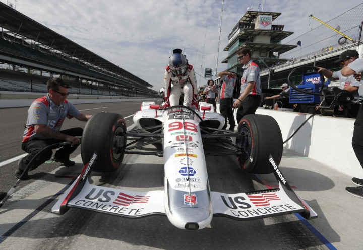 Marco Andretti climbs into his car during practice fort the IndyCar Indianapolis 500 auto race at Indianapolis Motor Speedway, in Indianapolis Tuesday, May 15, 2018. (AP Photo/Michael Conroy)