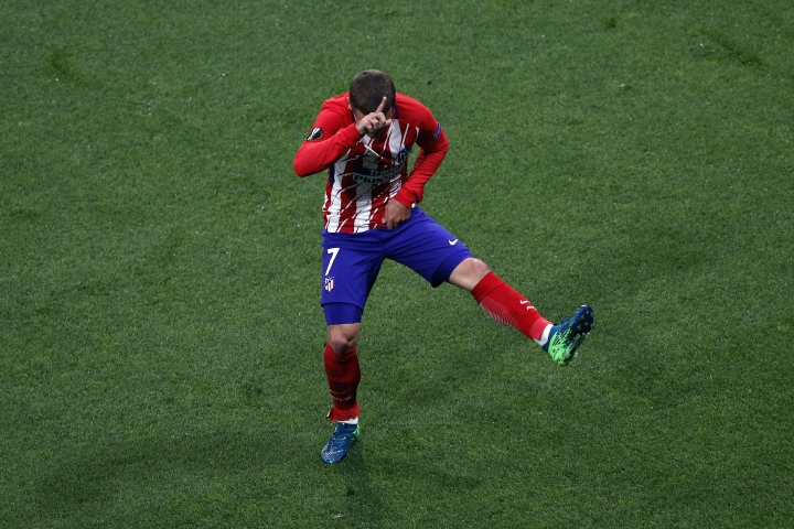 Atletico's Antoine Griezmann's celebrates his side opening goal during the Europa League Final soccer match between Marseille and Atletico Madrid at the Stade de Lyon outside Lyon, France, Wednesday, May 16, 2018. (AP Photo/Christophe Ena)