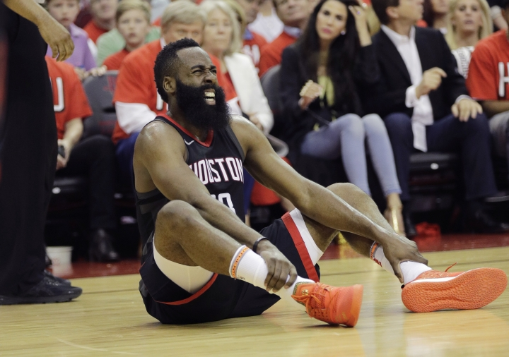 Houston Rockets guard James Harden reacts after he was injured during the first half of Game 1 of the NBA basketball Western Conference Finals against the Golden State Warriors, Monday, May 14, 2018, in Houston. (AP Photo/David J. Phillip)